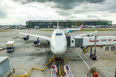 LONDON, UNITED KINGDOM - AUGUST 19, 2014: Brithis Airways Boeing. 747 at London Heathrow airport with some more aircrafts on background Stock Photo