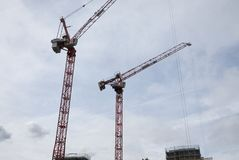 Cranes in the sky of London royalty free stock image