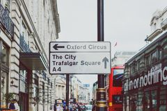 Oxford Circus city and Trafalgar Sqare street sign in London ciy. LONDON, UNITED KINGDOM - August 2nd, 2014: Oxford Circus city and Trafalgar Sqare street sign Stock Images