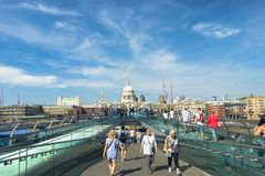 People walking on the famous Millennium Bridge in London, United Kingdom Stock Image