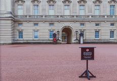 Queen`s Guard standing outside of Buckingham Palace. LONDON, UNITED KINGDOM - August, 20th, 2015: Queen`s Guard standing outside of Buckingham Palace Royalty Free Stock Photo