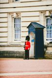 Queen`s Guardstanding outside of Buckingham Palace. LONDON, UNITED KINGDOM - August 8th, 2014: Queen`s Guardstanding outside of Buckingham Palace Royalty Free Stock Images