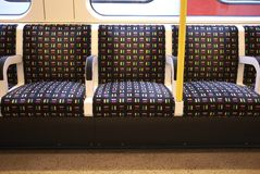 View of the Underground seats. London, United Kingdom - August 27, 2017 : Underground empty seats Royalty Free Stock Photos