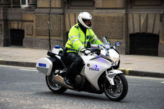 London/United Kingdom - 05/06/2012 - British Metropolitan Police Officer riding Motorbike for Offical Escort of the Royal Family o Stock Images