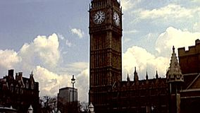Big Ben with flags of Europe in London. London, United Kingdom - Circa 1977: Big Ben clock tower in Parliament Square with flags of Europe and the United Kingdom stock video footage