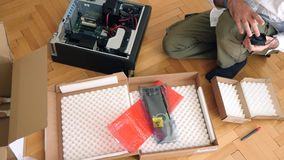 Man unpacking computer parts for upgrade of the Brocken computer dell parts. LONDON, UNITED KINGDOM - CIRCA 2017: Computer geek unboxing unpacking for Dell stock video