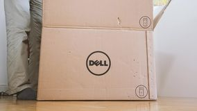 Man unboxing new Dell Computer Precision Workstation. LONDON, UNITED KINGDOM - CIRCA 2017: Man geek unboxing unpacking Dell computer box in living room stock video