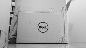 Time-lapse fast motion unboxing new computer Dell. LONDON, UNITED KINGDOM - CIRCA 2017: Man geek unboxing unpacking Dell Workstation Server Dell Precision T7920 stock footage