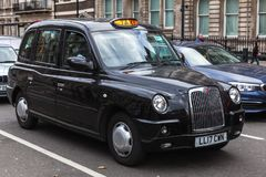 London, United Kingdom, classic black taxi cab. London, United Kingdom - October 29, 2017: Black taxi cab by The London Taxi Company is on the street royalty free stock photography