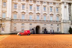 London, United Kingdom - 12/19/2017: Even the Queen gets post. London, United Kingdom - 12/19/2017: A Royal Mail post van driving through the Buckingham Palace Royalty Free Stock Photos