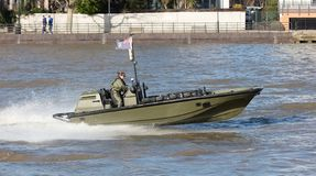 Small boat of the Royal Navy practicing on the Thames on februari 21, 2019. London, United Kingdom - Februari 21, 2019: Small boat of the Royal Navy practicing stock image