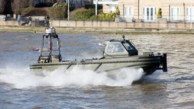 Small boat of the Royal Navy practicing on the Thames on februari 21, 2019. London, United Kingdom - Februari 21, 2019: Small boat of the Royal Navy practicing stock photos