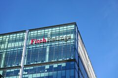 London, United Kingdom - February 03, 2019: Fitch Ratings logo signage at top of their Headquarters in UK other is in New York,