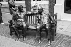London, United Kingdom - February 25, 2010: sculpture of men sit on bench in bronze. Allies sculpture on street. Friends. On bench shows relationship. Journey royalty free stock photo