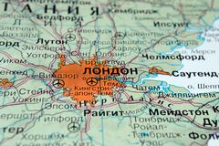 London. United Kingdom on a geographical map with Russian text. Selective focus stock photos