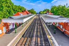 London, The United Kingdom of Great Britain: Colorful London train station Stock Image
