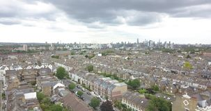 London, the United Kingdom, Great Britain, England, Clapham Common Park, aerial, drone footage. With many detached, semi-detached and terraced houses. London`s stock video