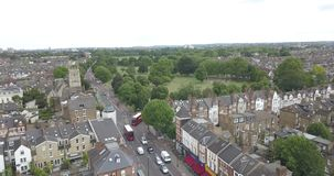 London, the United Kingdom, Great Britain, England, Clapham Common Park, aerial, drone footage with many trees and buses. London, the United Kingdom, Great stock video