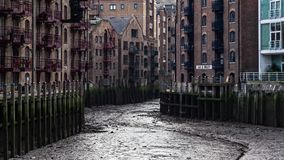 London, United Kingdom - January 27, 2007: Java wharf dried when river Thames is low. This usually nice riverside location looks. Sullen without water royalty free stock photos