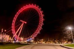 London Eye Giant Ferris Wheel illuminated at night in London, UK Stock Photography