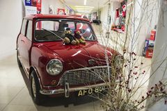 Old red Mini Austin in London, England, United Kingdom. London, United Kingdom - January 3, 2018: Old red Mini Austin in the shop window of a car shop in London royalty free stock photos