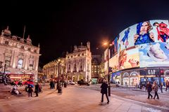 Piccadilly Circus with billboards,people and city traffic in Lon. London, United Kingdom- January 10, 2018:Piccadilly Circus with billboards,people and city Stock Photo