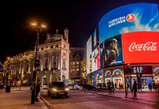 Piccadilly Circus with billboards,people and city traffic in Lon. London, United Kingdom- January 10, 2018:Piccadilly Circus with billboards,people and city Royalty Free Stock Photos