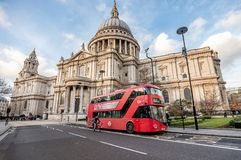 Red bus in front of Saint Pauls Cathedral in London, UK stock images