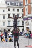 Covent Garden Market,popular shopping and tourist site,black circus performers on the street, London, United Kingdom. LONDON, UNITED KINGDOM - JUNE 22, 2017 Royalty Free Stock Photos