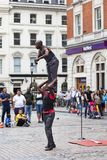 Covent Garden Market,popular shopping and tourist site, show of  black circus performers on the street, London, United Kingdom. LONDON, UNITED KINGDOM - JUNE 22 Stock Photography