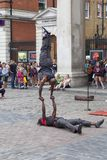 Covent Garden Market,popular shopping and tourist site, show of black circus performers on the street, London, United Kingdom. LONDON, UNITED KINGDOM - JUNE 22 Stock Images