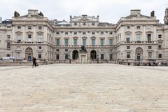 Neoclassical building Somerset House in the district Covent Garden, London, United Kingdom. LONDON, UNITED KINGDOM - JUNE 22, 2017: Neoclassical building royalty free stock photo