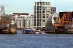 Thames Barrier and Thames Clipper in Woolwich, London, United Kingdom. London, United Kingdom - June 23, 2018: Thames Barrier in Woolwich, London, United Kingdom stock image