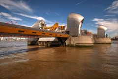 Two piers of Thames Barrier in Woolwich, London, United Kingdom. London, United Kingdom - June 23, 2018: Two piers of Thames Barrier in Woolwich, London, United royalty free stock photos