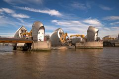 Two piers of Thames Barrier in Woolwich, London, United Kingdom. London, United Kingdom - June 23, 2018: Two piers of Thames Barrier in Woolwich, London, United royalty free stock photo