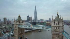 4K aerial footage of the famous Tower Bridge on a cloudy morning stock footage