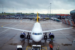 LONDON, UNITED KINGDOM - March 10, 2015: Refueling Monarch Airlines' airplane on Gatwick airport in London, UK. Royalty Free Stock Photography