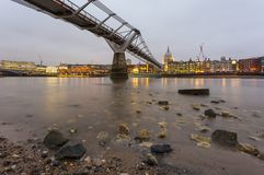 Side view of Millennium Bridge with Saint Paul Cathedral on background. London, United Kingdom- March 10, 2017: Side view of Millennium Bridge with Saint Paul Royalty Free Stock Photography