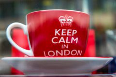 A Cup and Saucer. London, United Kingdom - March 27, 2015: In a storefront window selling a cup and saucer with the phrase Keep Calm in London stock photo