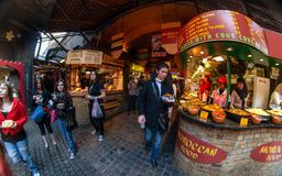 London, United Kingdom - March 31, 2007: Unknown shoppers eating street food while walking at Camden Lock, famous market royalty free stock photos