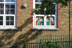 London, United Kingdom - May 04, 2020: Children hand drawn colourful rainbows displayed in window of house in Lewisham, as a thank