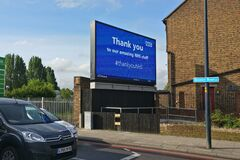 London, United Kingdom - May 04, 2020: Light Ad display with thank you note to NHS, displayed at Lewisham street during