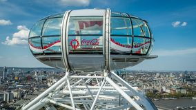 The London skyline with an isolated London eye capsule. London, United Kingdom - 8 May, 2016 : The London skyline with an isolated London eye capsule with clear royalty free stock photo