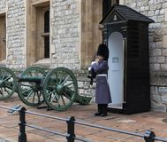 LONDON, UNITED KINGDOM - NOVEMBER 24, 2018: Royal Guard at Tower of London. Young soldier guarding Crown Jewels. Autumn stock images