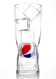 LONDON,UNITED KINGDOM-OCTOBER 03, 2016: Original empty pepsi cola glass with ice cubes. Pepsi is a carbonated soft drink that is p Royalty Free Stock Image