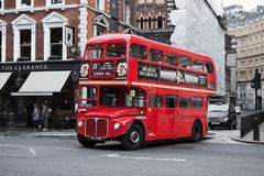 Red double-decker bus on London street. London, United Kingdom - October 21, 2017: Red double-decker bus goes on the street, one of the most popular symbols of Stock Photo