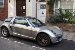 Silver metallic Smart Roadster Coupe car. London, United Kingdom - October 30, 2017: Silver metallic Smart Roadster Coupe car stands on the street in London city Stock Photography