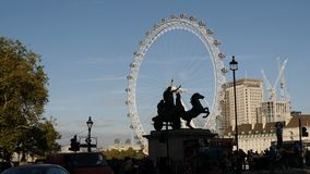 London, United Kingdom - October 20, 2017: Statue of Boadicea and Her Daughters located at the Westminster Bridge in the backgroun. D of London eye stock video footage