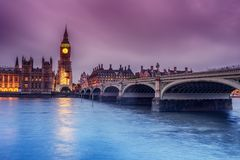 London, the United Kingdom: the Palace of Westminster with Big Ben, Elizabeth Tower, viewed from across the River Thames. At night Royalty Free Stock Photo