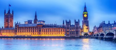 London, the United Kingdom: the Palace of Westminster with Big Ben, Elizabeth Tower, viewed from across the River Thames. At night Royalty Free Stock Image
